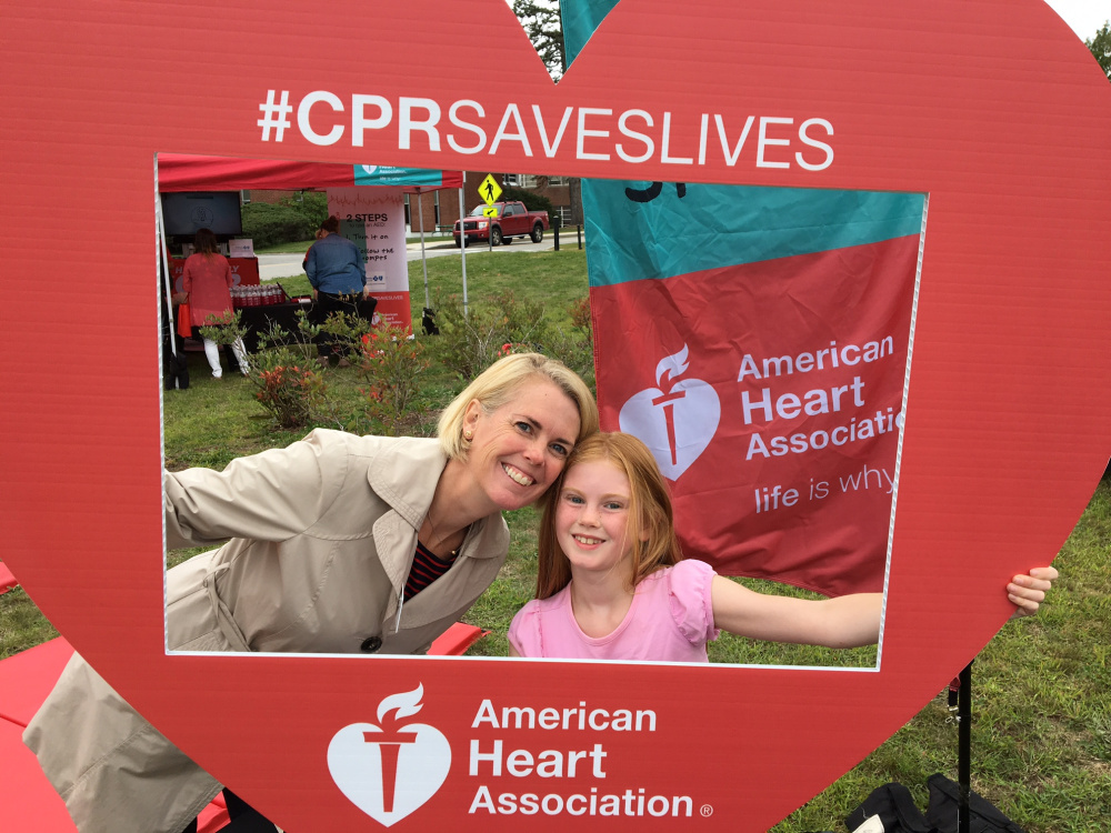 American Heart Association's Government Relations Director Becky Smith with daughter Ceclia.