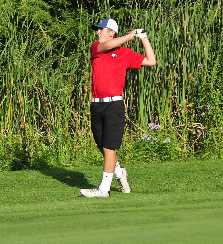 Cony's Jake Whitney watches a shot during a Kennebec Valley Athletic Conference match against Messalonskee on Monday at Belgrade Lakes Golf Course.