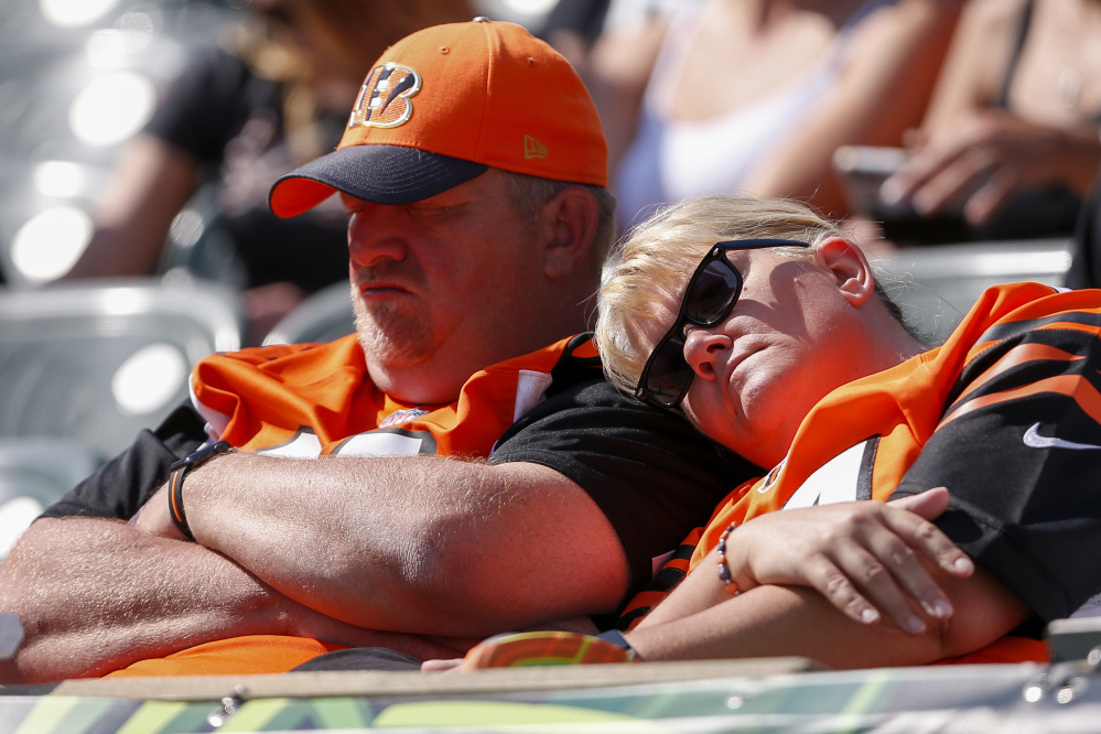 Cincinnati Bengals fans rest in the second half of a game against the Baltimore Ravens on Sunday.