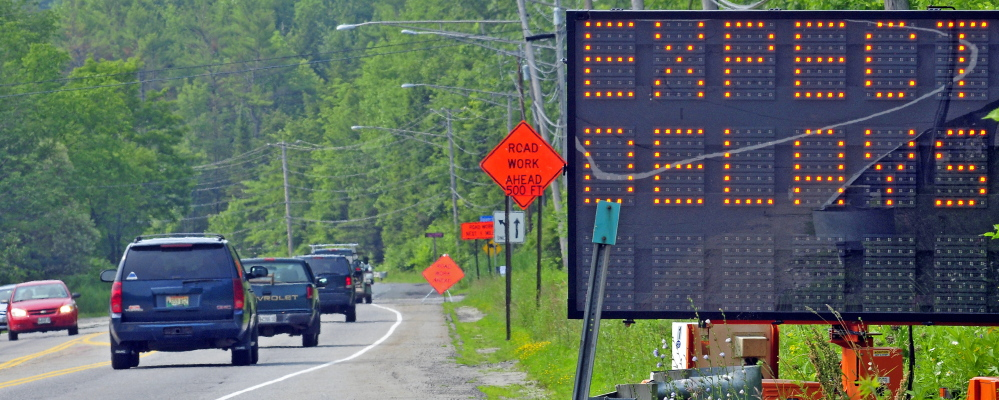 A file photo from 2015 warns motorists about the major construction project on Mount Vernon Avenue in Augusta, where a road crew currently is working on repairs to stonework along the busy corridor.
