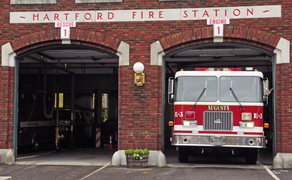 Augusta firefighter/paramedic Kevin Curry shows what a tight fit it is as he moves Engine 3 to another bay in 2014 at Hartford Fire Station. The station is scheduled to undergo an expansion starting this month, and the part of Gage Street that runs next to it will be closed to traffic permanently.
