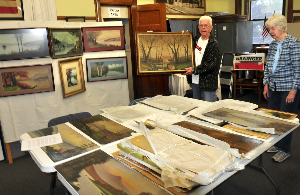 Lon Pelton, a relative of the late artist Willis Pelton, and his wife, Jane, look over artwork that will be part of a show from 10 a.m. to 3 p.m. on September 16 at the Old Point Avenue School in Madison. Willis Pelton lived in Starks in the late 1800s.