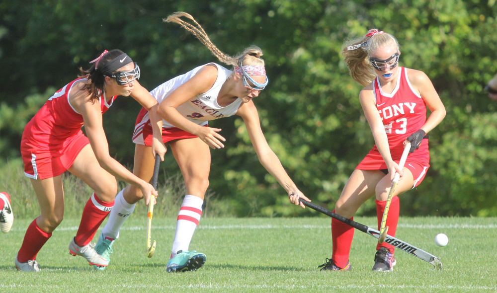 Messalonksee High School's Ally Turner, center, fights for the ball with with Cony High School's Olivia Varney, left, and Anna Reny during first-half action in Oakland on Thursday.