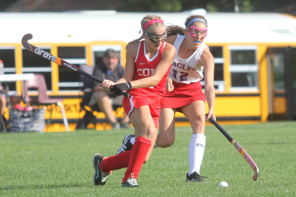 Messalonskee High School's Sarah Kohl (12) tries to take the ball from Cony High School's Julia Reny during first-half action on Thursday in Oakland.