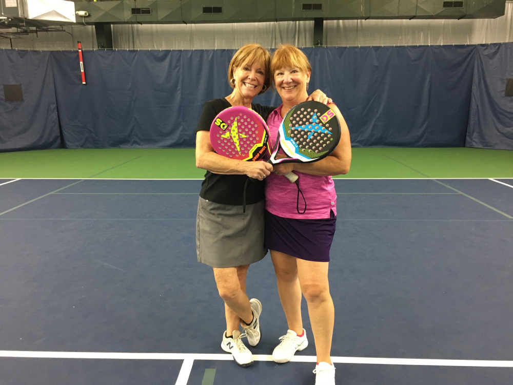 From left, Sally Read and Christina Rao display the new types of tennis rackets used in POP Tennis, which will be demonstrated Sept. 29 at A-Copi Tennis and Sports Center in Augusta.