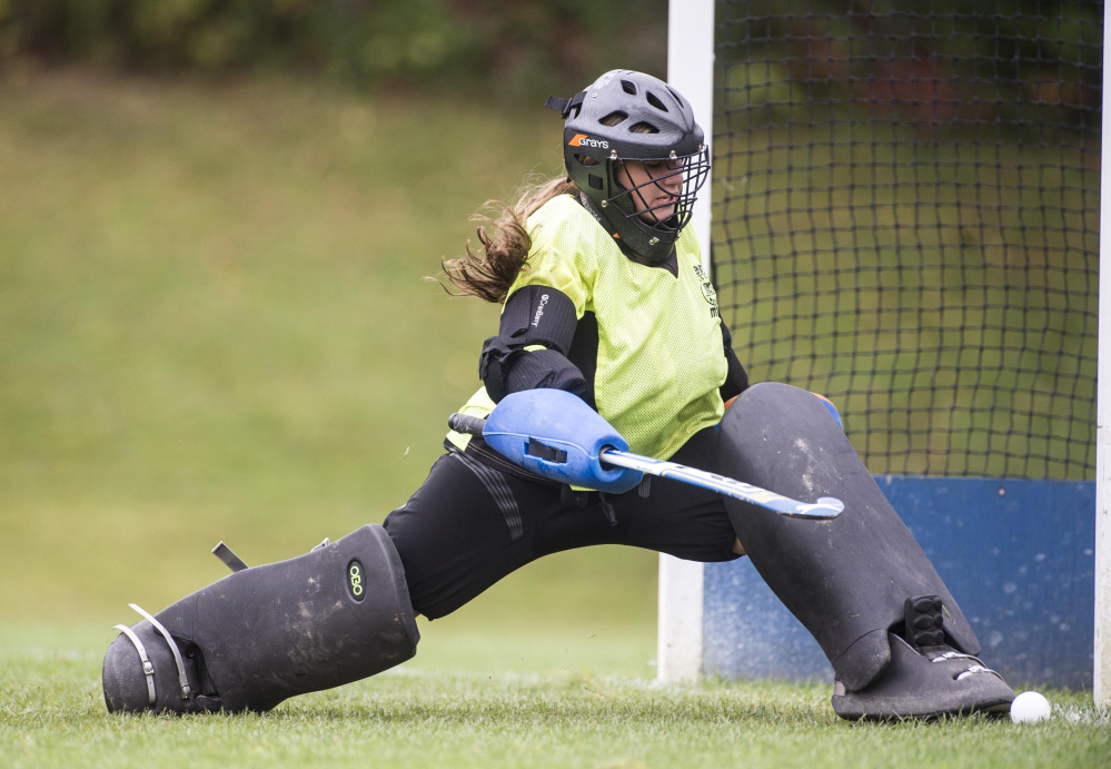 Winslow High School goalie Cassie Demers (28) makes a save against Lawrence High School in Fairfield on Saturday.