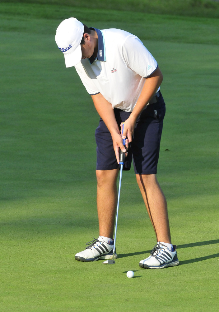Messalonskee senior Blake Marden focuses on a putt during a Kennebec Valley Athletic Conference match against Cony earlier this season at Belgrade Lakes Golf Course.