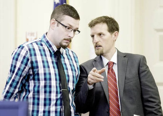 Timothy Danforth, left, talks with his co-counsel, Jeffrey Wilson, prior to the start of Danforth's murder trial in Franklin County Superior Court on Monday.
