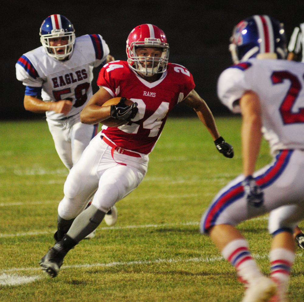 Cony's Jordan Roddy runs the ball during a game against Messalonskee at Alumni Field in Augusta last year.
