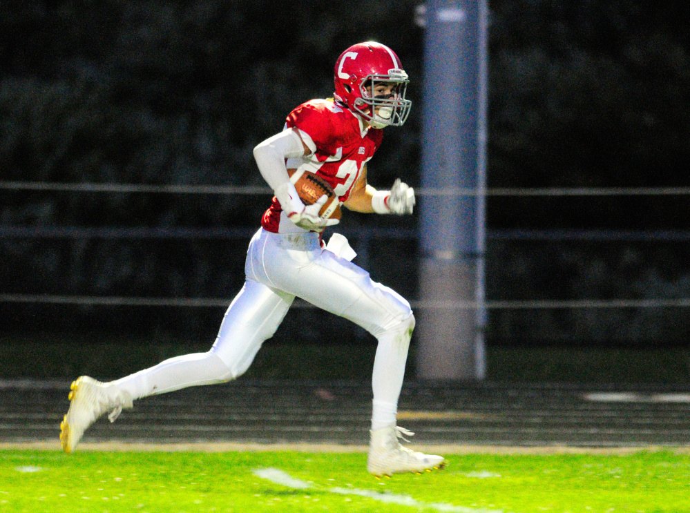 Cony's Elijah Dutil scores a touchdown on a long pass from a flea flicker during a recent game against Falmouth in Augusta.