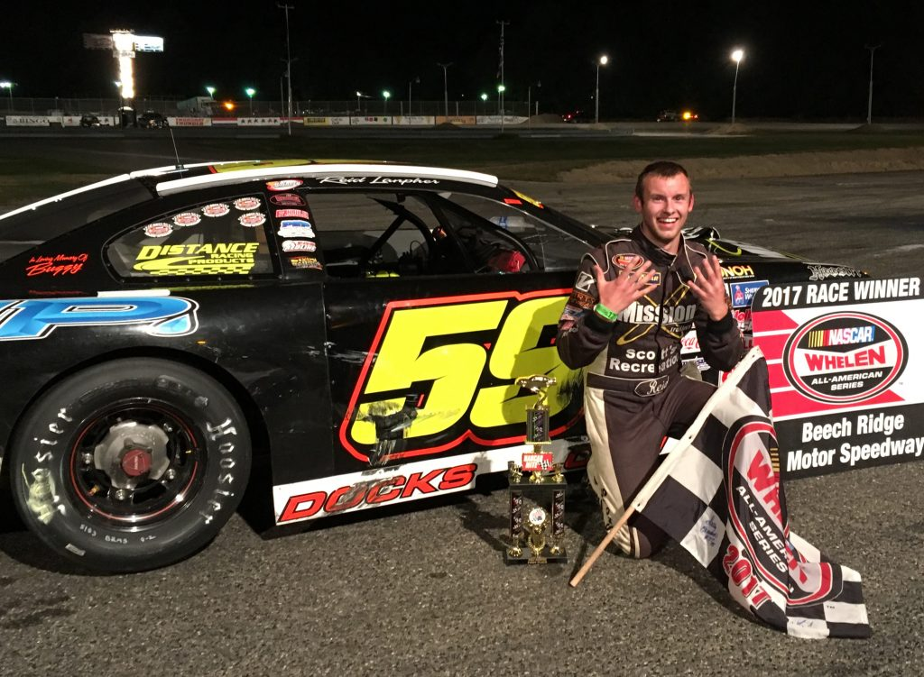 Reid Lanpher of Manchester celebrates his ninth win of the season, including his fourth in a row at Beech Ridge Motor Speedway, on Saturday night in Scarborough.