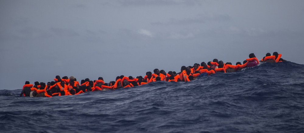 Sub-Saharan migrants wait to be rescued by aid workers off the coast of Libya in February.