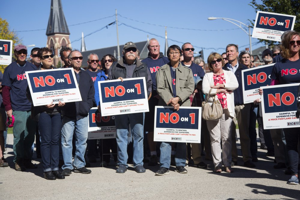Opponents of a Portland rent stabilization ballot question hold a rally in Lincoln Park on Thursday. It was organized by Say No to Rent Control.