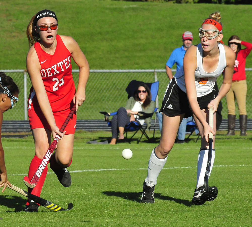 Dexter's Hayley Rossman and Winslow senior forward Haley Ryder go after a ball during a game Monday in Winslow.