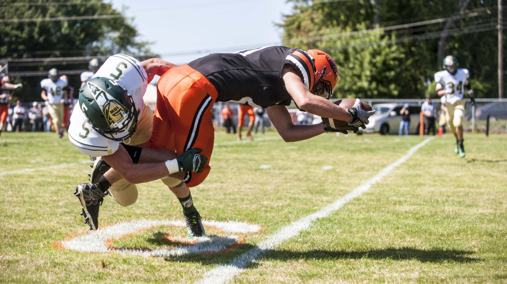 Winslow running back Benjamin Dorval (41) stretches over the goal line for a touchdown during a game against Mount Desert Island earlier this season.