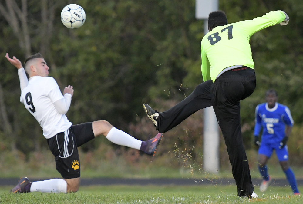 Maranacook's Micah Charette attempts to block a kick by Lewiston goalie Dido Lumu during a Kennebec Valley Athletic Conference game this season in Readfield.