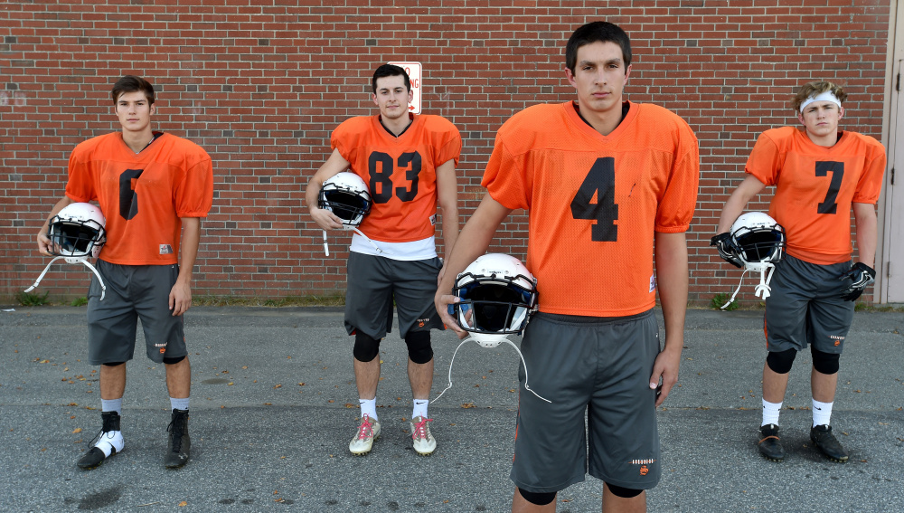 Skowhegan quarterback, Marcus Christopher, right foreground, stands with his top receivers, from back left, Sean Savage, Cam Barnes, and Jon Bell on Wednesday afternoon.