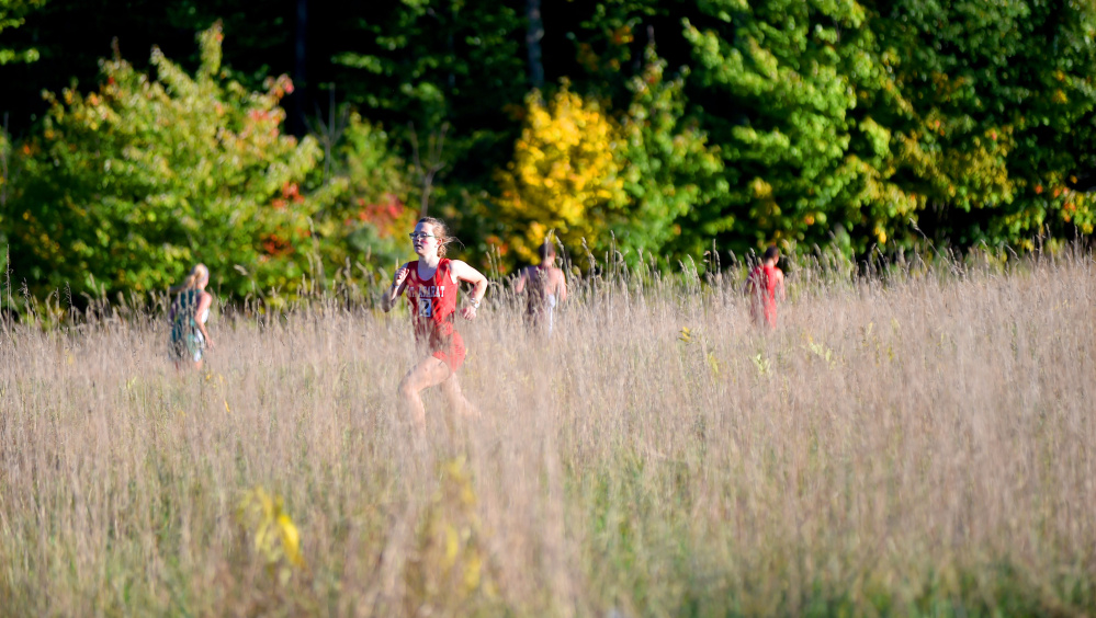 Runners make their way through the course Friday at the annual Mt. Blue Relays in Farmington.