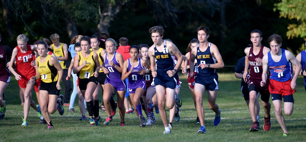 Runners take off from the start of the Mt. Blue Relays on Friday in Farmington.