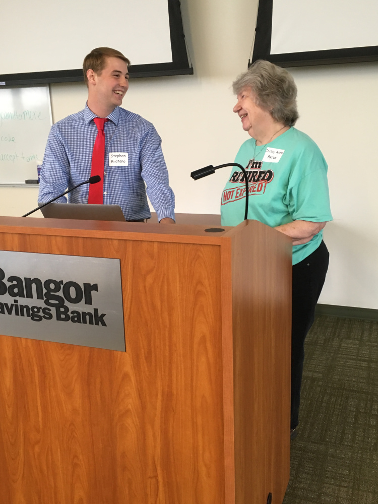 University of Maine at Farmington senior Steve Riitano confers with MEA-Retired President Corley Anne Byras before his session on Facebook began.