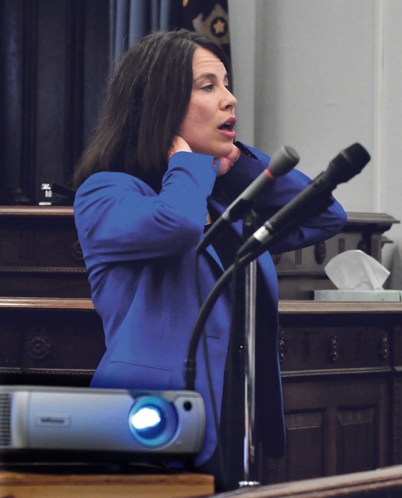 Kennebec and Somerset County District Attorney Maeghan Maloney illustrates being choked as she gave closing arguments to the jury in the domestic violence case against Andrew Maderios in Somerset County Superior Court in Skowhegan on Sept. 4, 2015.