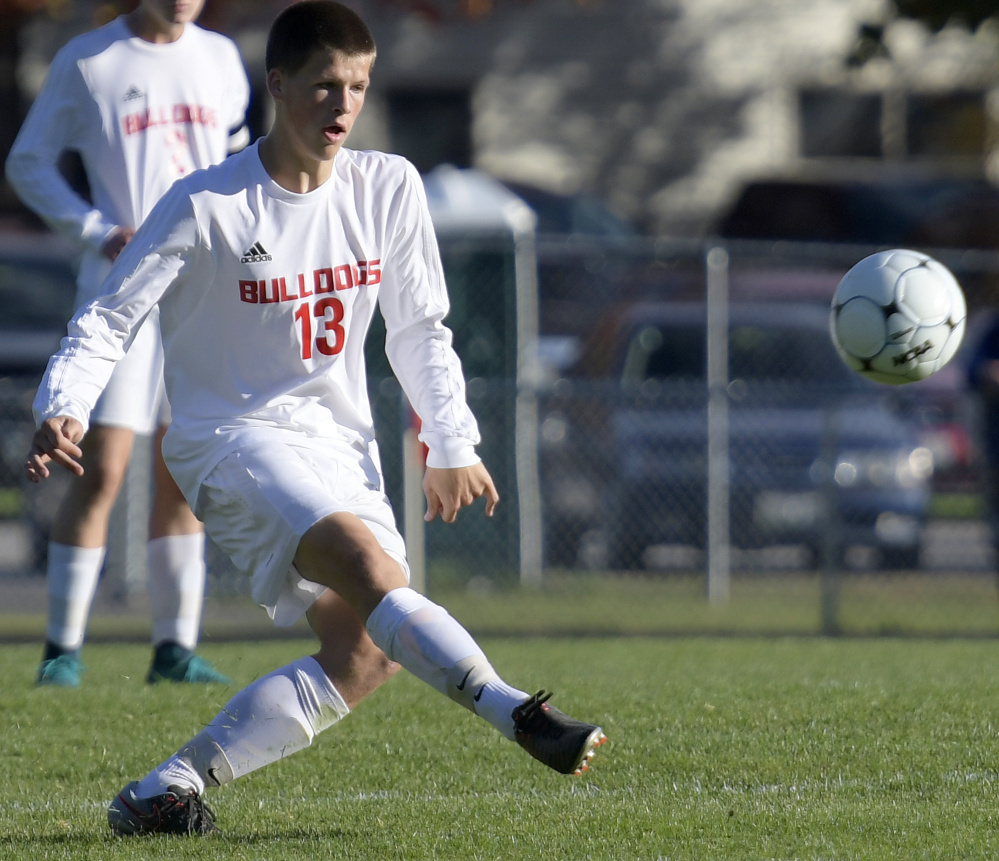 Hall-Dale's Matt Albert boots the ball during a game Tuesday against Mt. Abram in Farmingdale.
