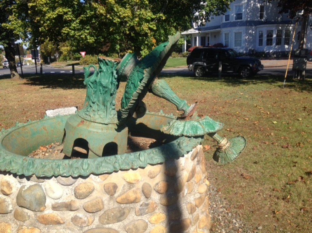 An ornate water fountain in a small grassy park on Main Street, Skowhegan, as it appeared Tuesday, having been broken by vandals a few days earlier.