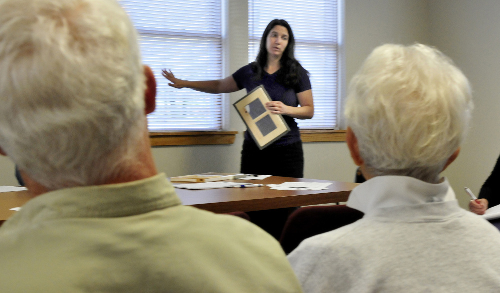 Laura Seaton, a representative of the WindowDressers program, explains on Wednesday how a window insert can reduce energy loss to members of the Vassalboro FAVOR committee.