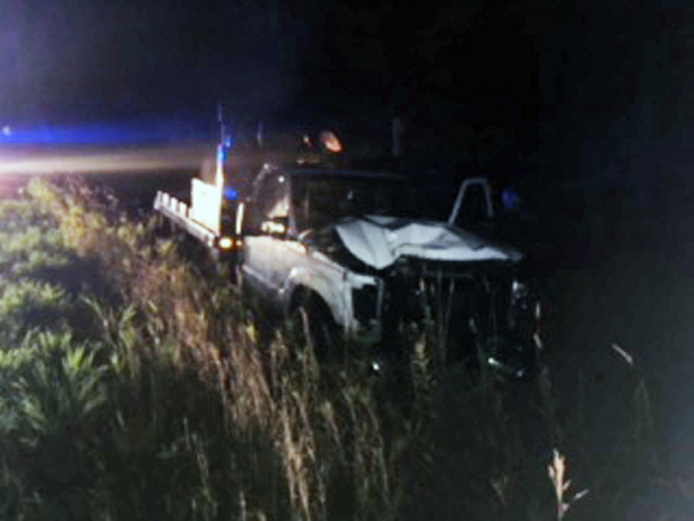 A Ford F-350 flatbed truck rests in a ditch Thursday night in Madison after it crashed. The driver was charged with operating under the influence.
