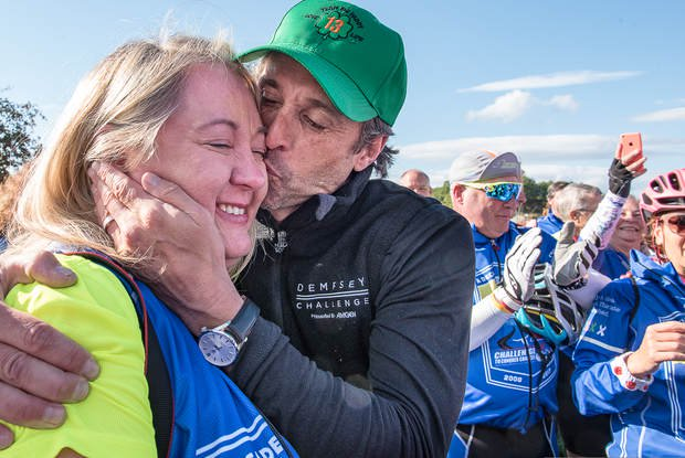Shannon Howard of Greenville, S.C., gets a kiss from Patrick Dempsey in Veterans Memorial Park in Lewiston on Friday.