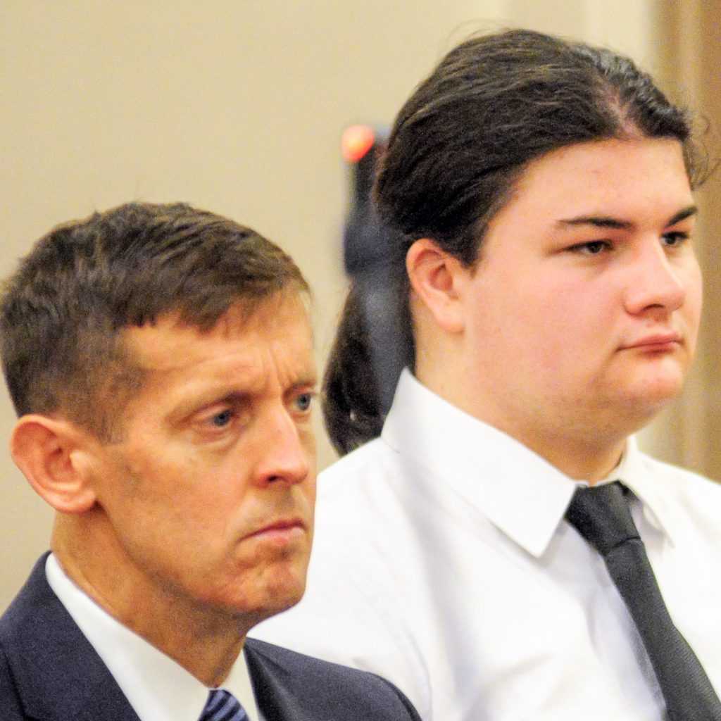 Teen accused of killing parents told 911 dispatcher he 'snapped'