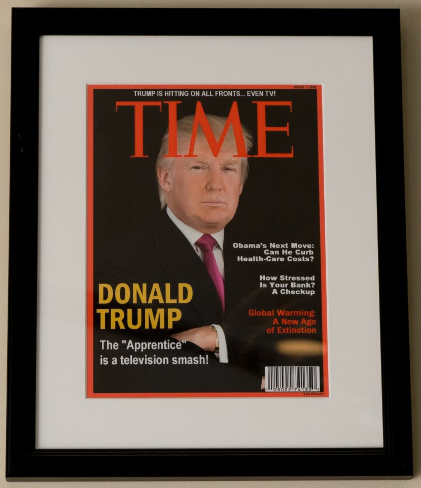 A portrait of Donald Trump graces the cover of a fake Time magazine hanging on a wall at the Trump National Doral Miami Golf Shop. The cover is dated March 1, 2009 – a date on which there was no issue of Time.