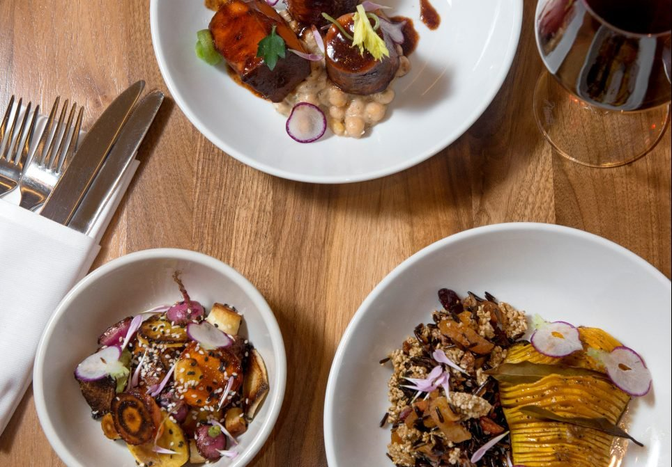 The vegan Thanksgiving dinner at Sea Glass at the Inn by the Sea in Cape Elizabeth will include, clockwise from top, carrot osso bucco with braised chickpeas, Hasselback butternut squash with wild rice and oat dressing, and roasted root vegetables with maple, soy and sesame.