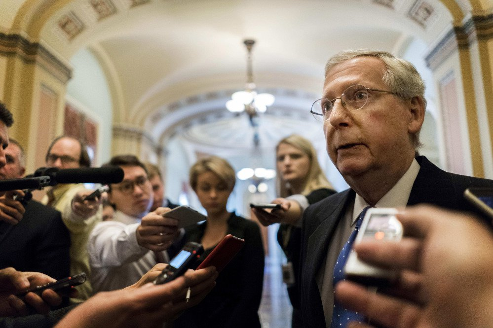 Senate Majority Leader Mitch McConnell talks to journalists about Alabama Senate candidate Roy Moore on Nov. 9 in Washington.