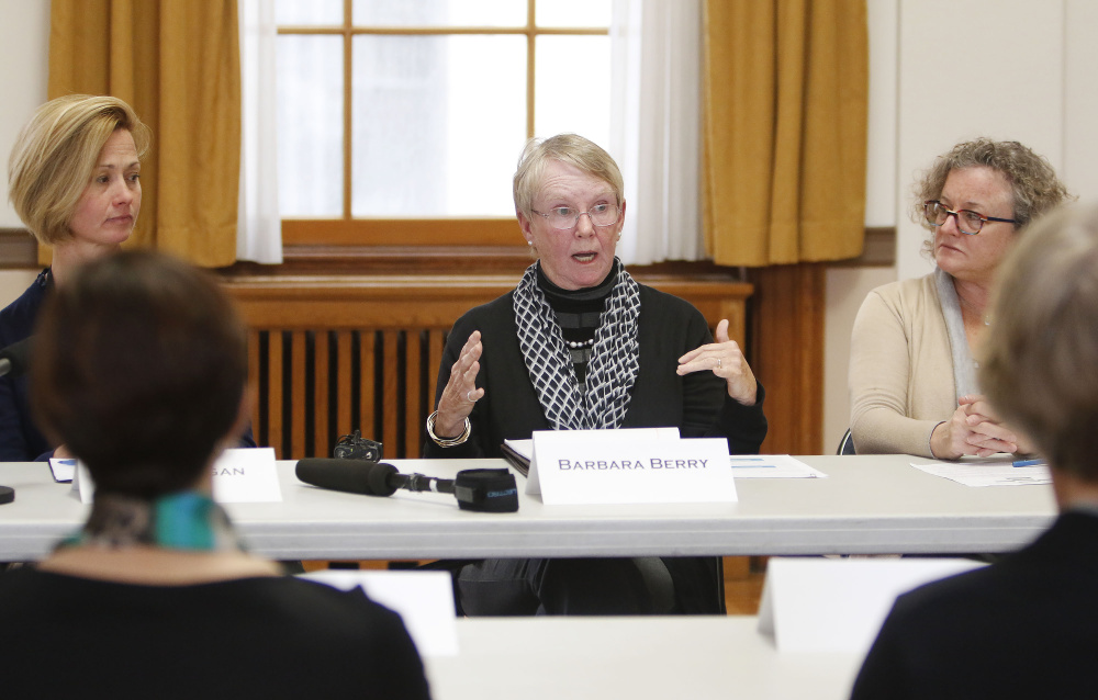 PORTLAND, ME - NOVEMBER 13: Portland High school teacher Sally Reagan, left, and Nancy Smith, of GrowSmart Maine, right, listen as Barbara Berry, center, a representative from the Maine Association of Realtors, discusses the mortgage deduction during a round-table discussion at City Hall with Congresswoman Chellie Pingree regarding the Republican tax plan, HR 1. (Staff photo by Jill Brady/Staff Photographer)