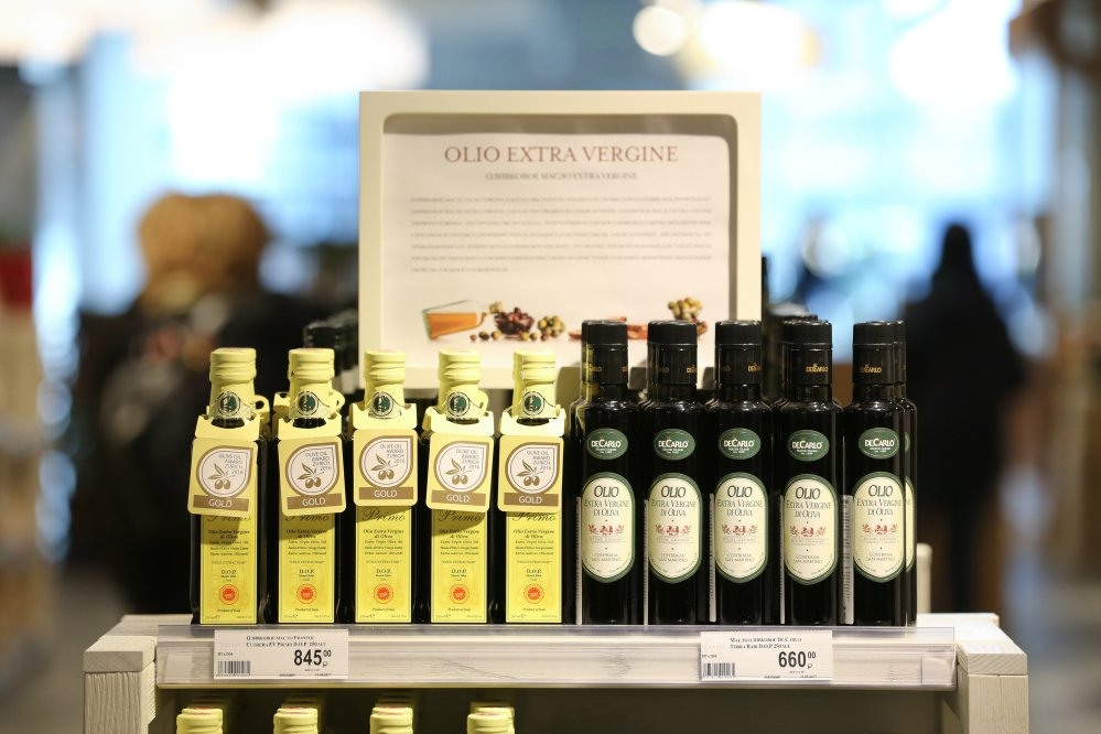 Olive oil is displayed at a food store in Moscow. Expected lower prices for olive oil may persuade homemakers and restaurants to switch back from sunflower-seed oil, which is cheaper.
