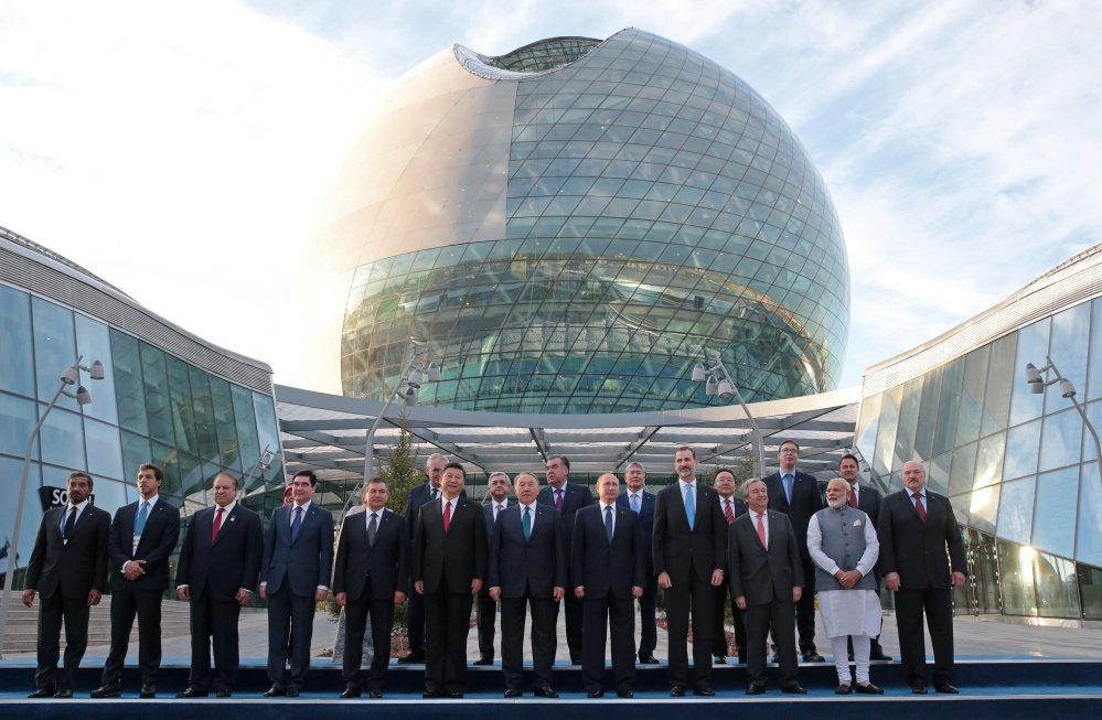 World leaders, including Russian President Vladimir Putin, center, pose for a photo with others as they attend the opening ceremony of the Astana Expo 2017 exhibition in Astana, Kazakhstan, in this June 9 file photo.