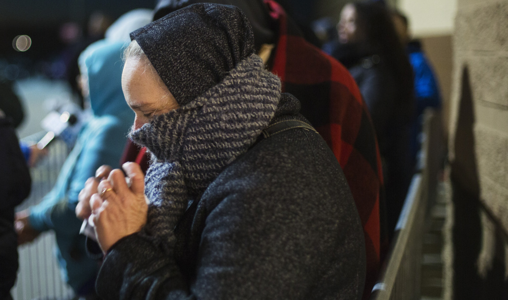 SOUTH PORTLAND, ME - NOVEMBER 24: Carol Rickett of Portland uses handwarmers while waiting in line for early Black Friday shopping at Target. (Photo by Derek Davis/Staff photographer)