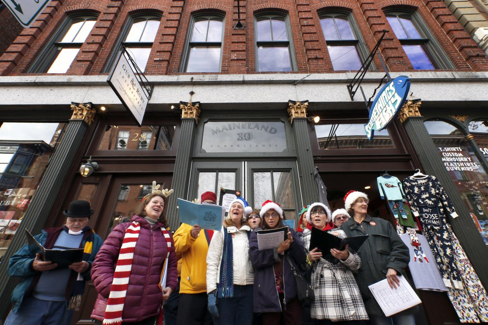 Members of the Portland Community Chorus perform outside Something's Fishy on Saturday. The store was among nearly 50 businesses participating in Shop for a Cause, with a portion of the proceeds going to Amistad, a mental health and addiction recovery center in Portland.