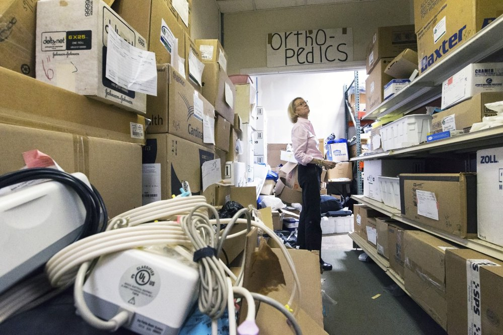 Elizabeth McLellan, founder of Partners for World Health, searches warehouse shelves for  boxes of orthopedic supplies to be shipped to Puerto Rico. She said the missions have grown to five or six year, with teams going to Tanzania, Libya, Peru, Uganda and Cameroon.