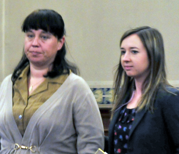 Defendant Miranda Hopkins, of Troy, left, enters Waldo County Superior Court in Belfast with her attorney, Laura Shaw, on Tuesday.