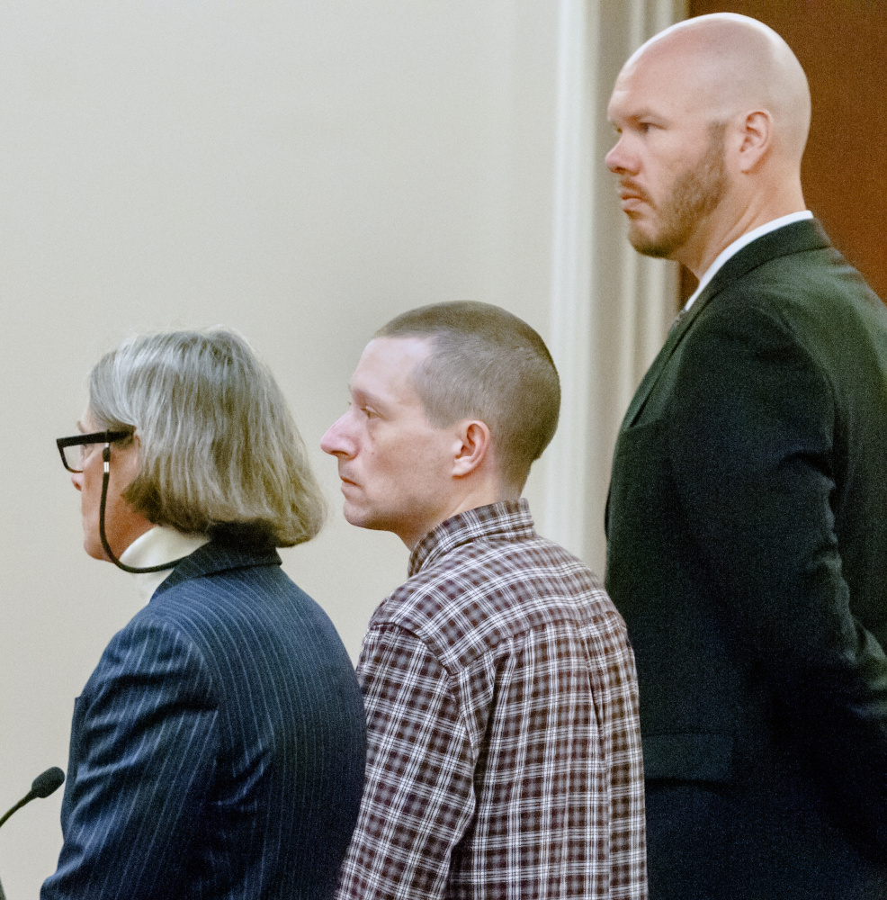 Scott A. Bubar, 40, center, is flanked by his attorneys, Lisa Whittier, left, and Scott Hess, during a bail hearing Wednesday at the Capital Judicial Center in Augusta. Bubar admitted having violated bail conditions established in connection with his attempted murder charge.