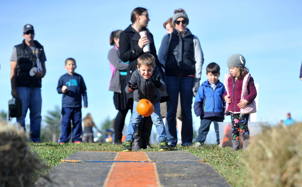 Isaac Provisor, 5, of Oakland, takes his turn at pumpkin bowling Saturday at the Fall Family Fun Day event at Quarry Road Trails in Waterville.