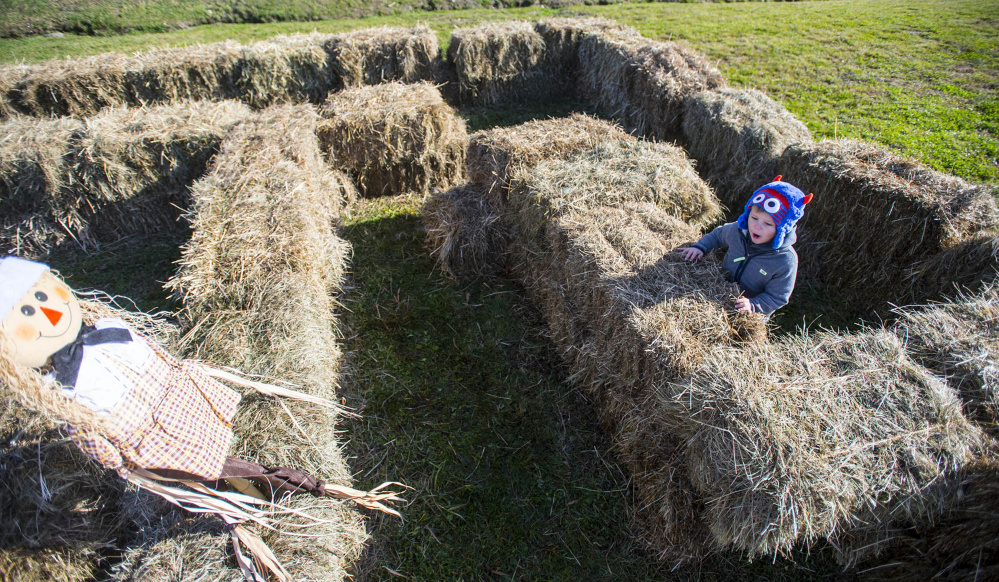 Griffin Laplante, 3, of Waterville, works his way through a hay maze Saturday at the Fall Family Fun Day event at Quarry Road Trails in Waterville.