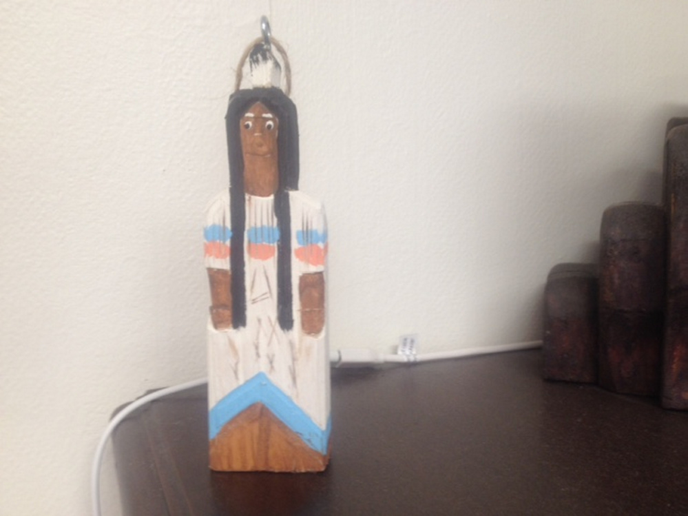 A small wooden figurine is seen at the Skowhegan Area Chamber of Commerce office that would have been used in its now-abandoned