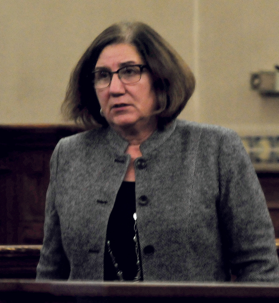 Assistant District Attorney Leanne Zainea walks back to her table following a sidebar with Justice Robert Murray and defense attorneys during the manslaughter trial of Miranda Hopkins of Troy in Waldo County Superior Court in Belfast on Monday.
