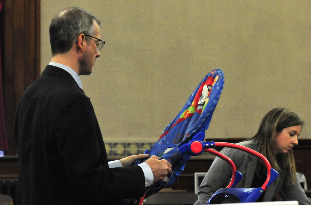 Defense attorneys Christopher MacLean and Laura Shaw showed the jury an infant seat used by deceased infant Jaxson Hopkins during the manslaughter trial of his mother, Miranda Hopkins of Troy, in Waldo County Superior Court in Belfast on Monday.