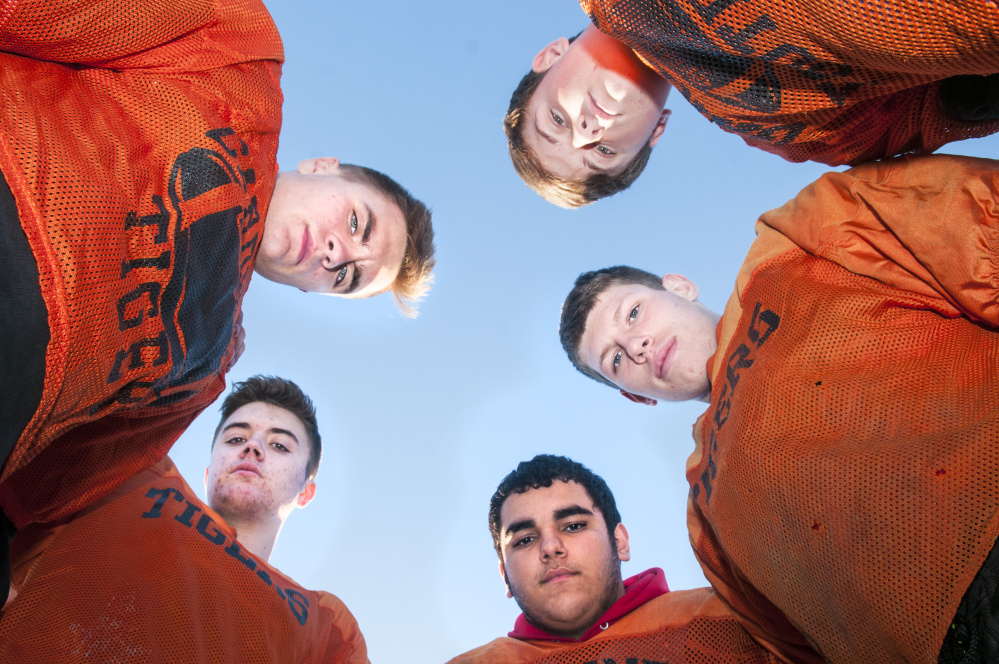 Defensive linemen, from left top, Roy Appleby, Austin Weymouth, Dylan Spencer, Michael Stratton and Brad Sandelin helped lead the Gardiner Tigers to the Class C South regional championship game.
