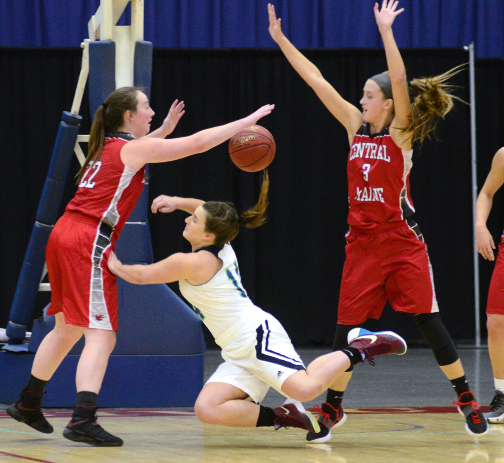 Central Maine Community College defenders Rylee Moore, left, and Alex Bessey flank University of Maine at Augusta's Catherine Sanborn, a Wayne native, during a game Wednesday at the Augusta Civic Center.