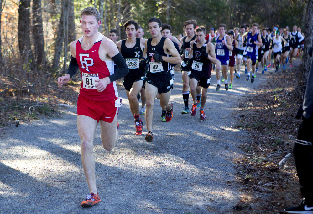 Fairfield (Connecticut) Prep runner Drew Thompson, left, leads the pack during the 83rd annual New England cross country championships Saturday at Troy Howard Middle School in Belfast. Thompson won the race.
